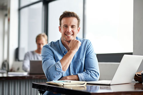 Image of man working at laptop
